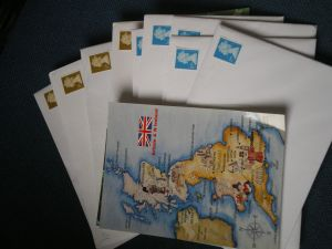 Prepare postcards and send them from every red postbox your find.