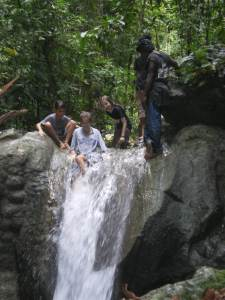 On top, behind and going over a waterfall. Parents either look away or check it's safe before they jump.