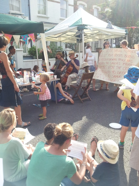 Plenty gong on at the street party - a sing song, cello performance, street play for the kids, chat for the adults and food sharing under the shady gazebo.