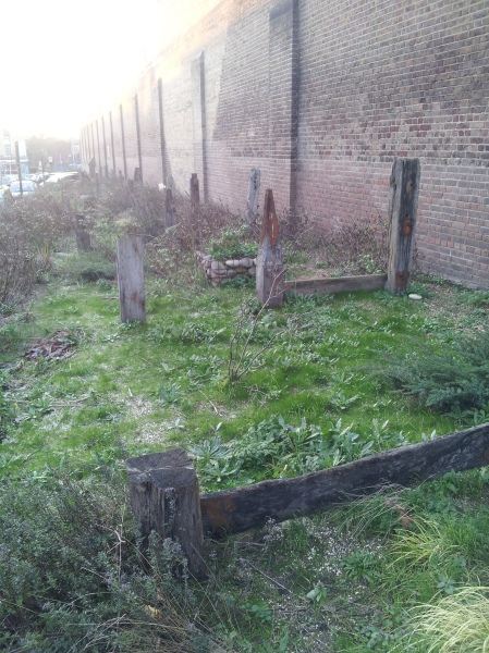 Strange structures by Pentonville Prison - possibly an echo of cattle stalls or maybe disused gardens. Or are they seaside posts?