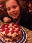 Ready to enjoy the birthday cake her big sister made - after the sleepover.