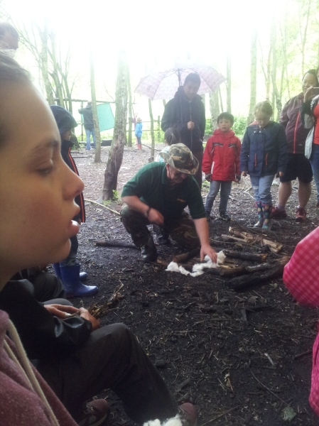 Conkers ranger John (in the hat) shows us how to use cotton wool to create a great fire. Nell looks a bit suspicious... but it all turns out OK.