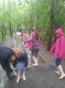 At Conkers in the National Forest, getting ready for the barefoot challenge is very simple - off with your shoes and socks. (c) homemadekids/nicola baird