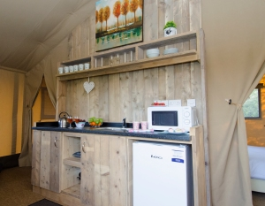 The kitchen in a safari tent - glamping removes the hardships from camping! (c) Park Resorts